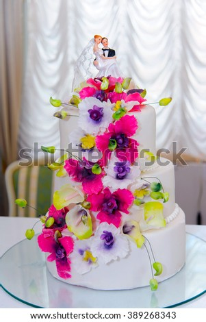 Luxury cake. Wedding cake for the Banquet. Stacked and layered cake for the holiday. Birthday cake. Delicious beautiful large cake for the celebrant. - stock photo