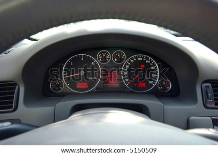 Luxury car dashboard closeup - stock photo