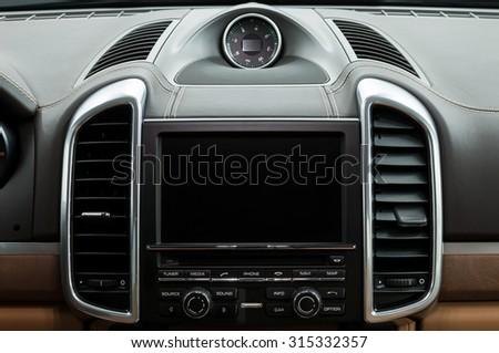 Luxury car dashboard. Multimedia screen. Interior detail. - stock photo