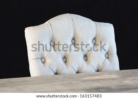 Luxury chair and table isolated at a dark background with selective focus - stock photo