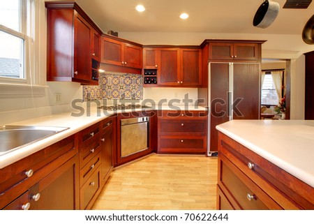 Luxury cherry kitchen with very beautiful wood - stock photo