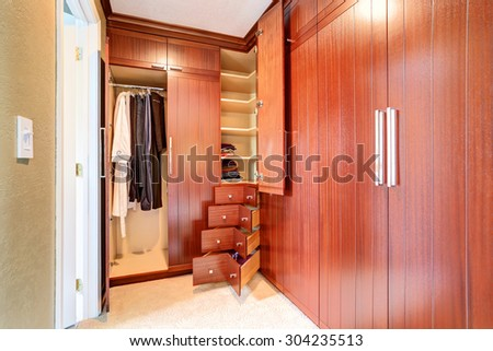 Luxury closet of master bedroom with lots of storage space. - stock photo