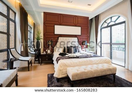 luxury comfortable bedroom with nice decoration - stock photo