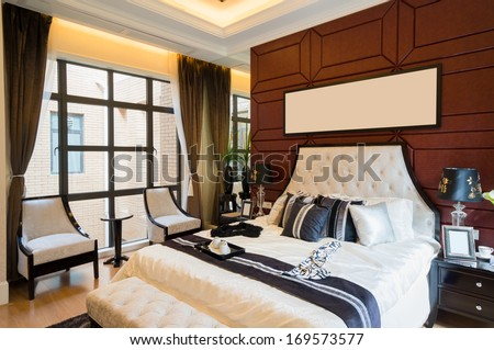 luxury comfortable bedroom with nice decoration - stock photo