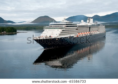 luxury cruise liner arriving in alaskan port of call on cloudy morning - stock photo