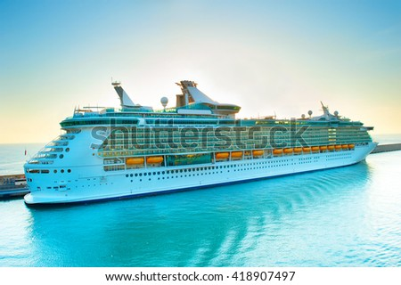 Luxury cruise liner in a port at sunset - stock photo