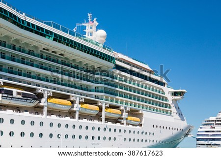 Luxury cruise ship docked under clear blue tropical skies - stock photo
