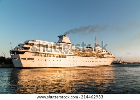 Luxury cruise ship in the port - stock photo