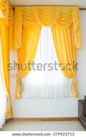 Luxury curtain in the window in room - stock photo