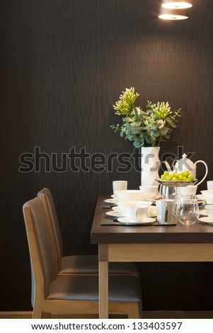 luxury dining table with glass and ceramic dishware. - stock photo
