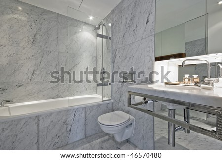 luxury en-suite bathroom in white marble finish - stock photo