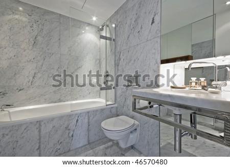 Luxury modern en suite bathroom with marble finish stock photo - Luxury En Suite Bathroom In White Marble Finish Stock Photo