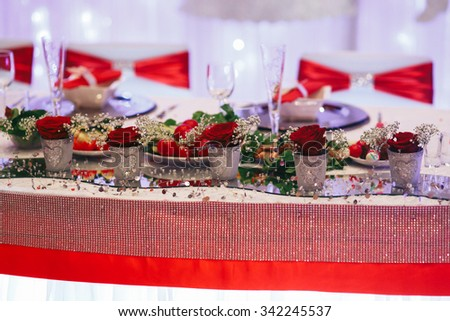 Luxury expensive catering and wedding reception decorations metal and diamonds with roses - stock photo