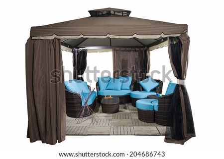 Luxury garden tent with complete set of rattan furniture inside, isolated on white - stock photo