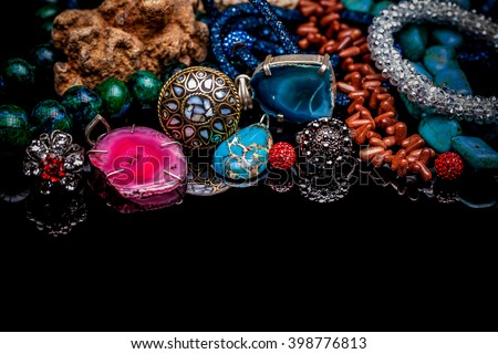 Luxury gemstone jewelry on black glossy table - stock photo