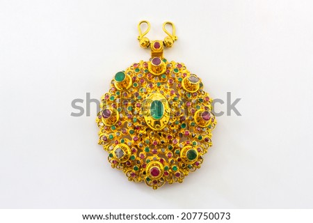 Luxury gold pendant in Thai ancient style on white background. - stock photo