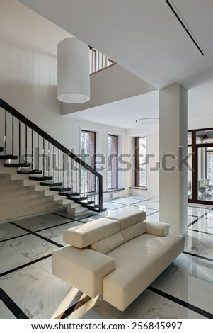 Luxury hall with big windows and staircase in modern style - stock photo