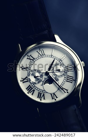 Luxury hand watch with leather wrist let stylised with Instagram retro blue effect - stock photo