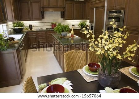 Luxury home dining table and a modern kitchen. - stock photo