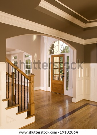 Luxury Home Entrance way with Arch Window - stock photo