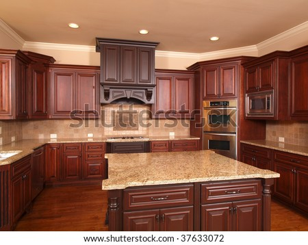 Luxury Home Kitchen front with center island and cabinets - stock photo