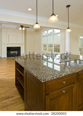 Luxury Home Kitchen with island and Family room - stock photo