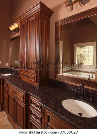 Luxury Home Tile Bathroom wood cabinets and double sink - stock photo