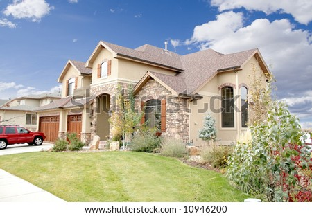 Luxury home with landscaping and blue sky - stock photo