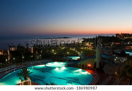 Luxury hotel pool at night - stock photo