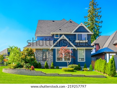 Luxury house in Vancouver, Canada against blue sky - stock photo