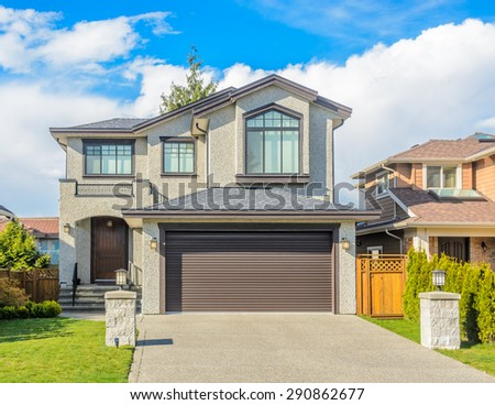 Luxury house in Vancouver, Canada against blue sky. - stock photo