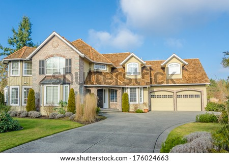 Luxury house in Vancouver, Canada against blue sky with clouds - stock photo