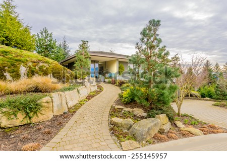 Luxury house in Vancouver, Canada. Limited number of colours. Brown, grey and green. - stock photo