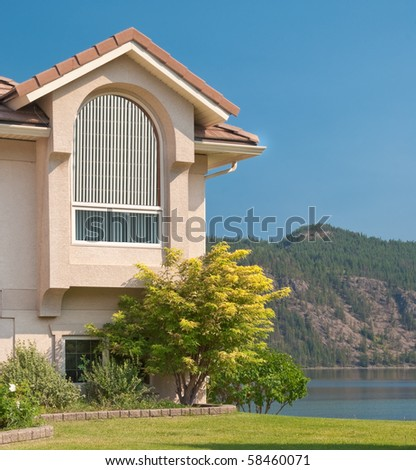 Luxury house over beautiful mountain lake in Vancouver, Canada. - stock photo