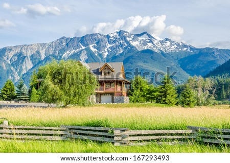 Luxury house over fantastic mountain view at sunny day in Vancouver, Canada. - stock photo