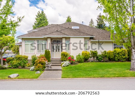 Luxury house with beautiful landscaping. Home exterior. - stock photo