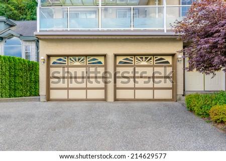 Luxury house with double garage door in Vancouver, Canada. - stock photo