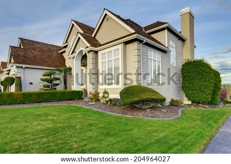 Luxury house with small entrance porch, walkway and curb appeal - stock photo