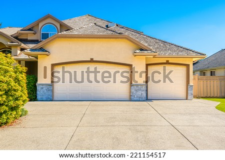 Luxury house with triple garage door in Vancouver, Canada. - stock photo