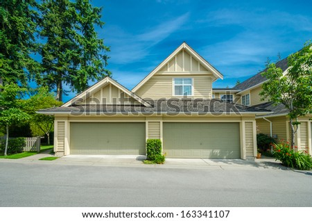 Luxury house with two double doors garages. Vancouver, Canada. - stock photo