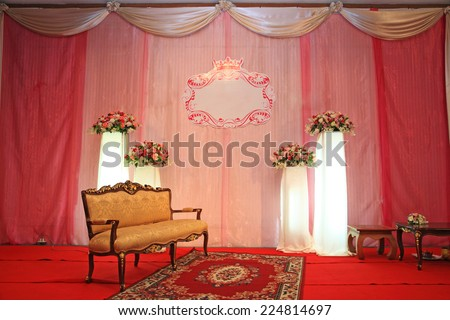Luxury Indoors Wedding Stage with Golden vintage chair - stock photo