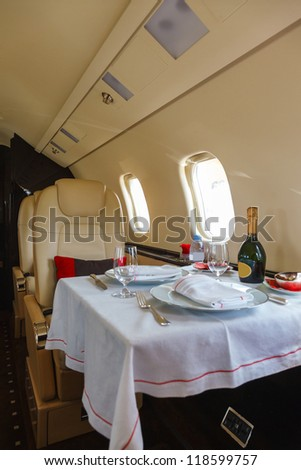 Luxury interior aircraft business aviation decorated table - stock photo