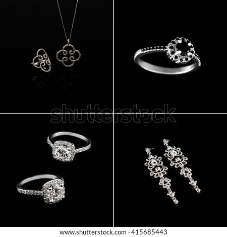 Luxury jewelry set. White gold or silver rings, earrings with crystals and pendant isolated on black. Selective focus - stock photo