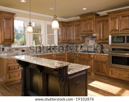 Luxury Kitchen two tier granite  island - stock photo