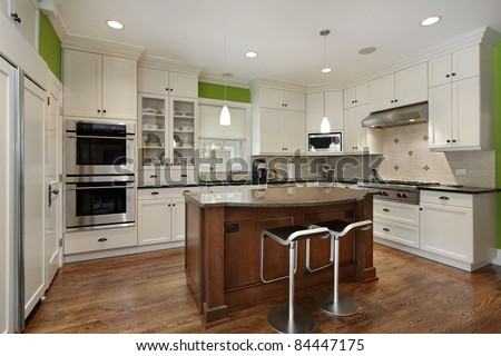 Luxury kitchen with island and white cabinetry - stock photo