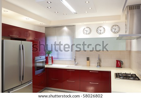 Luxury kitchen with red and marble elements - stock photo