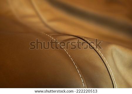luxury leather cushion detail  - upholstery - stock photo