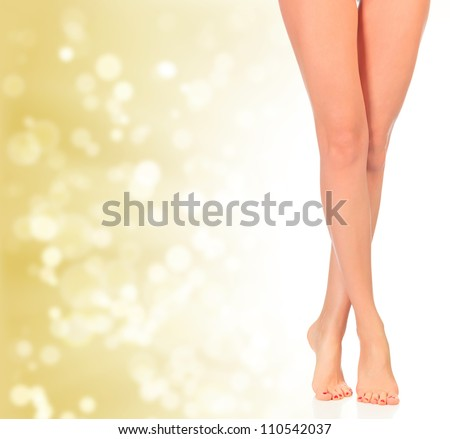 Luxury legs on golden background with blurred lights - stock photo