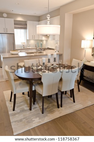 Luxury living suite : dining room and the kitchen at the back . - stock photo
