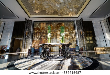 Luxury lobby interior.With crystal lamp,bing hall, marble floor, french sash,mosaic tile,comfortable sofa, reception desk and long Escalators. - stock photo